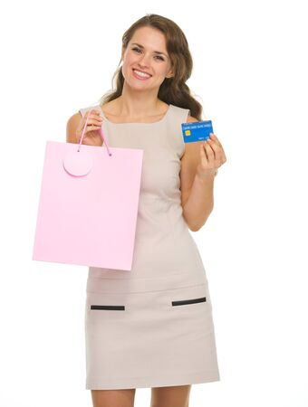 Smiling young woman with shopping bags and credit card Stock Photo - 16882303