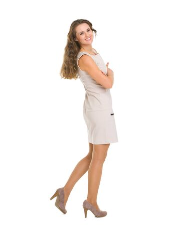 Full length portrait of smiling young woman in dress Stock Photo - 16882276