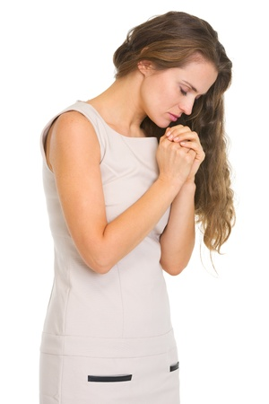 humility: Young woman praying Stock Photo
