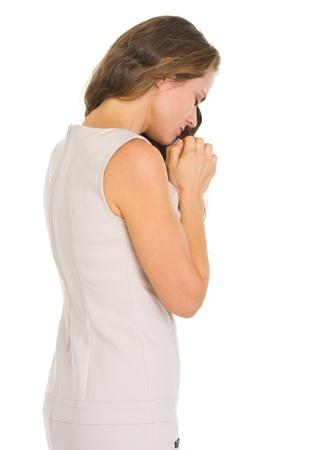 humility: Mujer joven rezando