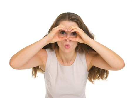 shaped hands: Surprised young woman looking through binoculars shaped hands Stock Photo