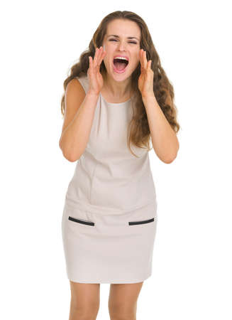 shaped hands: Young woman shouting through megaphone shaped hands Stock Photo