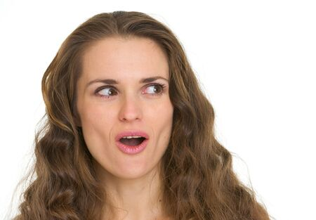 Portrait of surprised woman looking on copy space Stock Photo - 16882365