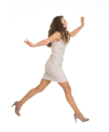 Young woman in dress jumping. Side view Stock Photo - 16882270