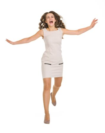 Young woman in dress jumping forward Stock Photo - 16882271