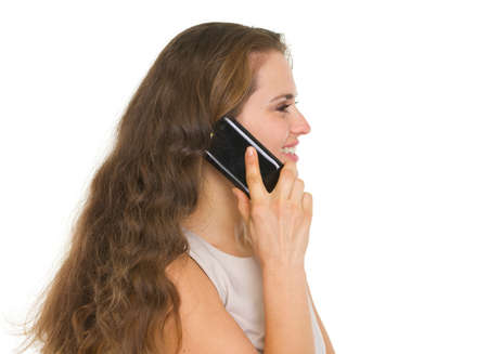 Smiling woman talking mobile phone. Side view Stock Photo - 16882347