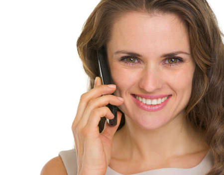 Portrait of beautiful young woman having mobile phone call Stock Photo - 16882362