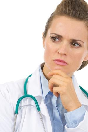 authoritative woman: Closeup on thoughtful medical doctor woman
