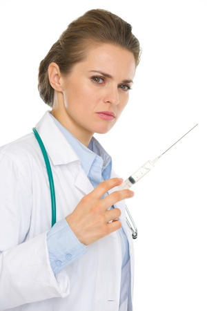 certitude: Serious medical doctor woman with syringe