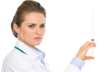 certitude: Serious medical doctor woman holding syringe Stock Photo