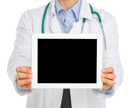 Closeup on medical doctor holding tablet PC with blank screen