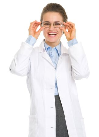 Smiling ophthalmologist doctor straitening glasses Stock Photo - 17056206