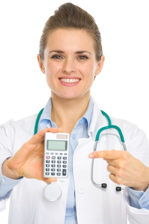 Closeup on medical doctor pointing on calculator Stock Photo - 17056153