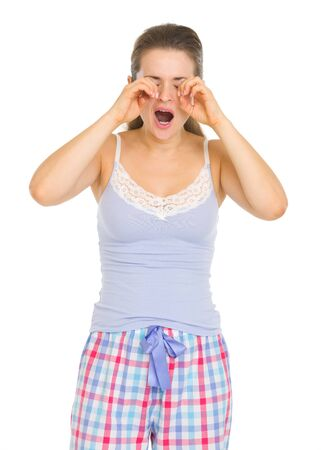 Young woman in pajamas rubbing eyes Stock Photo - 17137390