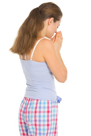 Young woman in pajamas praying before sleep. Rear view Stock Photo - 17137383