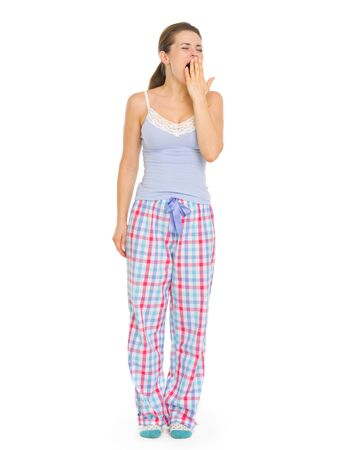 Young woman in pajamas yawing Stock Photo - 17137378