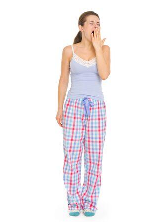 wakening: Young woman in pajamas yawing