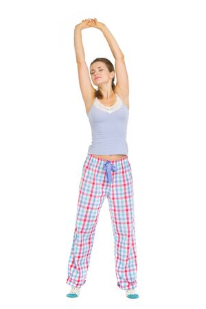 Young woman in pajamas stretching after sleep Stock Photo - 17137335