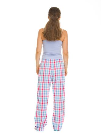 Full length portrait of young woman in pajamass. Rear view Stock Photo - 17137450