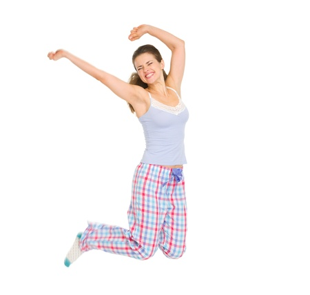Happy girl in pajamas jumping 版權商用圖片