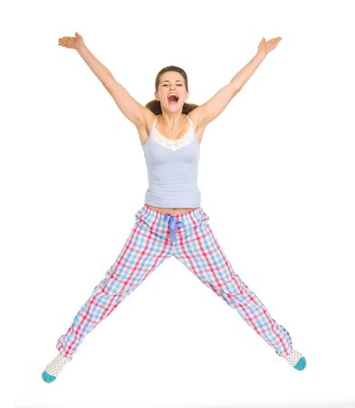 Smiling young woman in pajamas jumping Stock Photo - 17137415