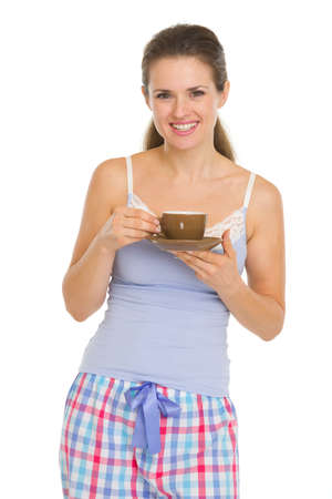Happy young woman in pajamas after sleep with cup of coffee Stock Photo - 17137387