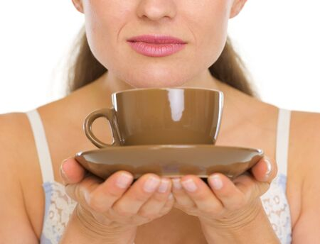 Closeup on cup of coffee in woman hands Stock Photo - 17137396