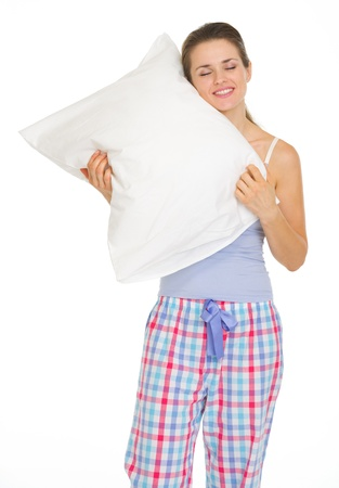 Young woman in pajamas enjoying cosy pillow Stock Photo - 17137394