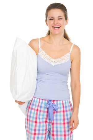 Happy young woman in pajamas holding pillow Stock Photo - 17137402