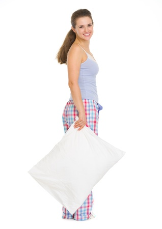 Full length portrait of young woman in pajamas with pillow Stock Photo - 17137443