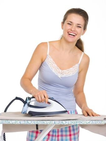 Young woman in pajamas ironing Stock Photo - 17137391