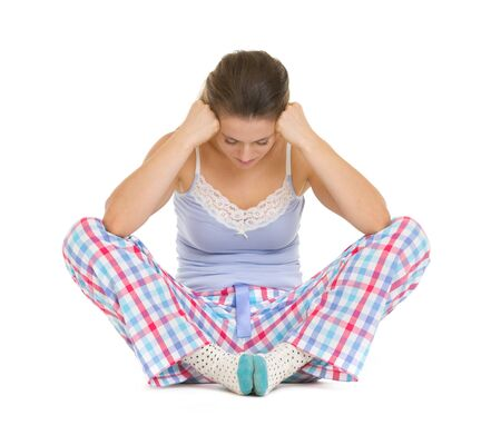 Stressed young woman in pajamas sitting on floor Stock Photo - 17137456