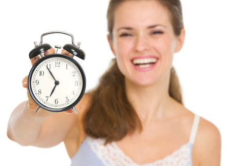arouse: Closeup on alarm clock in hand of happy woman