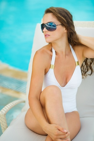 Portrait of glamour young woman in swimsuit relaxing on chaise-longue Stock Photo - 17283156