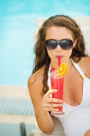 Portrait of young woman in swimsuit drinking cocktail Stock Photo - 17283124