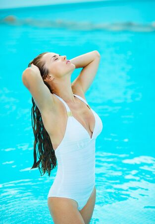 Young woman relaxing in pool Stock Photo - 17283128