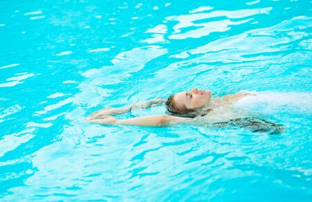 Young woman swimming in pool Stock Photo - 17283142
