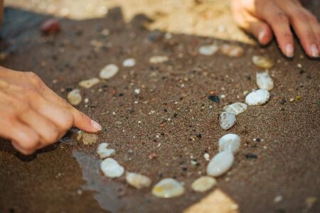 Closeup on rocks laid out in shape of heart on sandy beach Stock Photo - 17308222