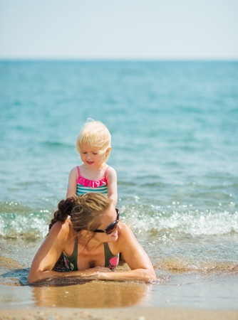Baby playing with mother on seashore Stock Photo - 17283137