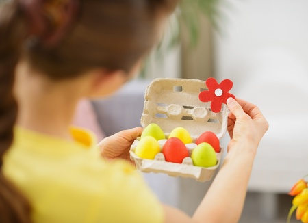 Woman making Easter decoration with colorful eggs Stock Photo - 17304815