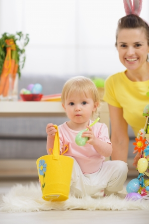 Baby playing with Easter decorations Stock Photo - 17304859