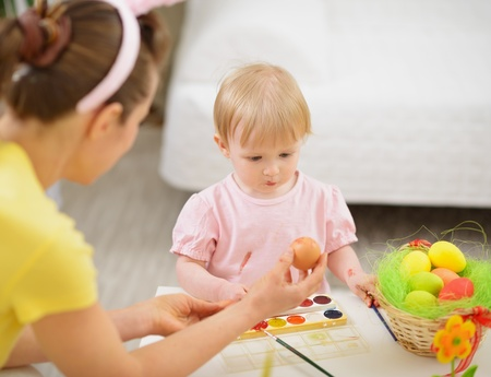 Mother and baby drawing on Easter eggs Stock Photo - 17304857