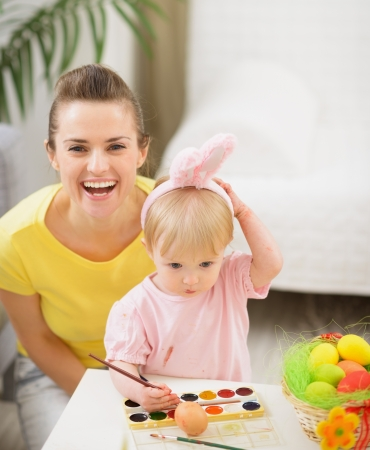 Baby and mother having fun on Easter photo