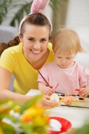 Mother and baby drawing on Easter eggs Stock Photo - 17304829