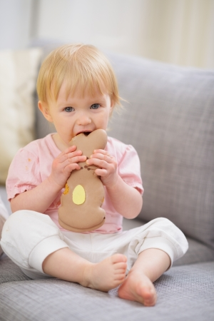 easter cookie: Baby eating Easter rabbit shaped cookie