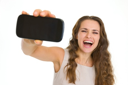 Happy young woman showing mobile phone Stock Photo - 17382832