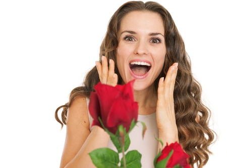 Surprised young woman receiving red roses Stock Photo - 17382824