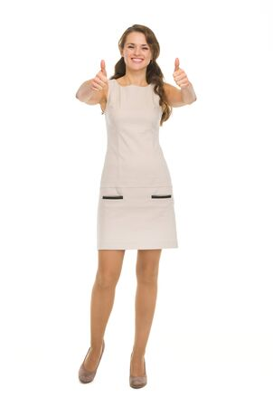 Full length portrait of happy young woman showing thumbs up Stock Photo - 17382846