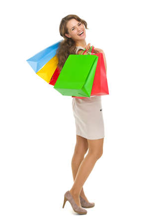 Full length portrait of smiling young woman with shopping bags Stock Photo - 17382848
