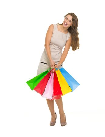 Full length portrait of happy young woman holding shopping bags Stock Photo - 17382851